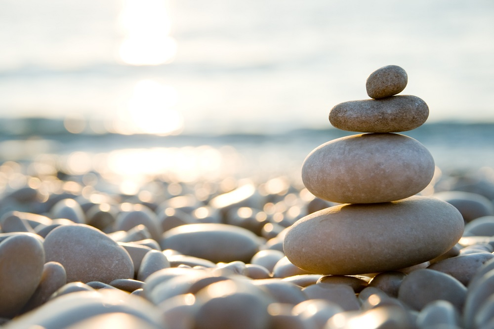 Rocks on beach positive light new day | Pandemic Positives Hospitality