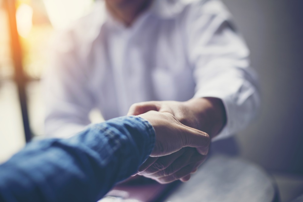 Professionals shaking hands | Tips on Salary and Package Negotiation