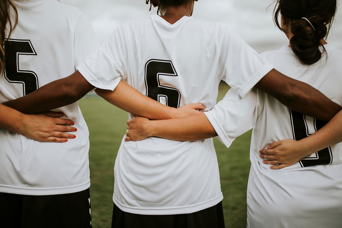Female,Soccer,Players,Huddling,And,Standing,Together
